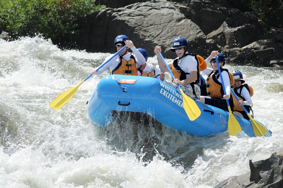 rafters paddling through rapid on south fork american river