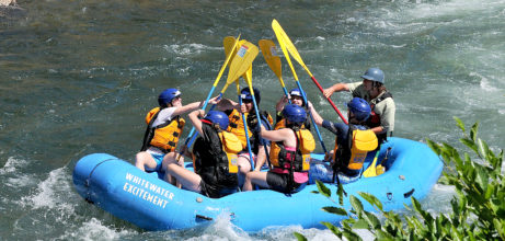 rafters give high five after whitewater rafting northern California